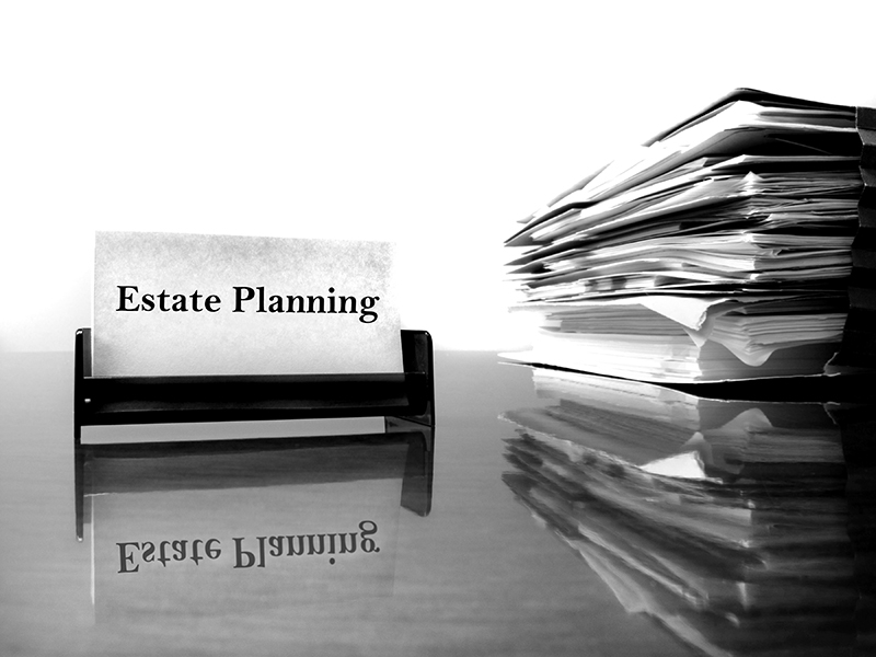 estate plannign printed on a page next to a stack of papers